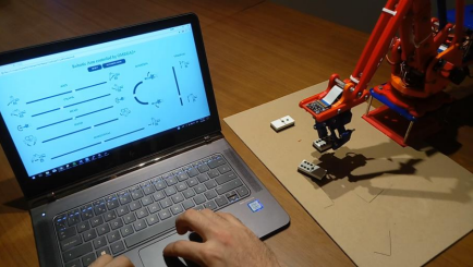 A Thesis On An Omega2-controlled Robot Arm