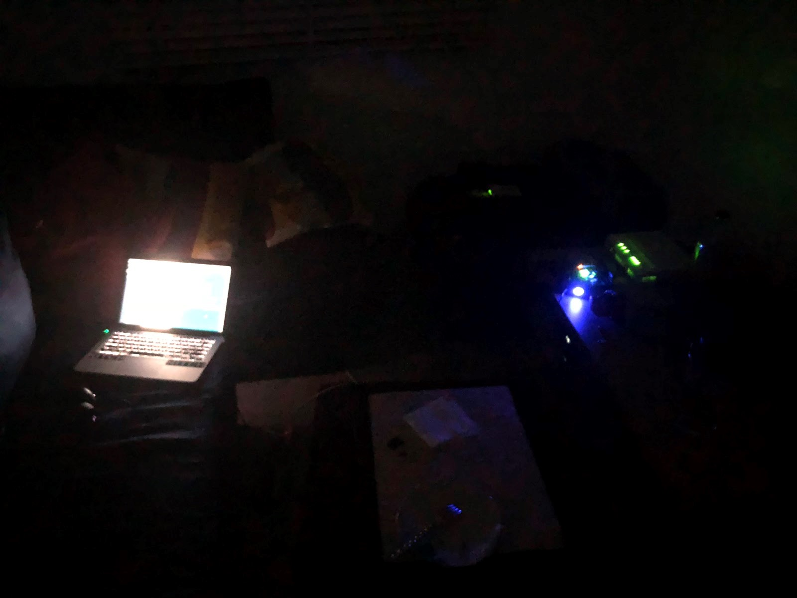 This is a picture of the HITCH team attempting to troubleshoot and resolder wires in the dark while the power was out.